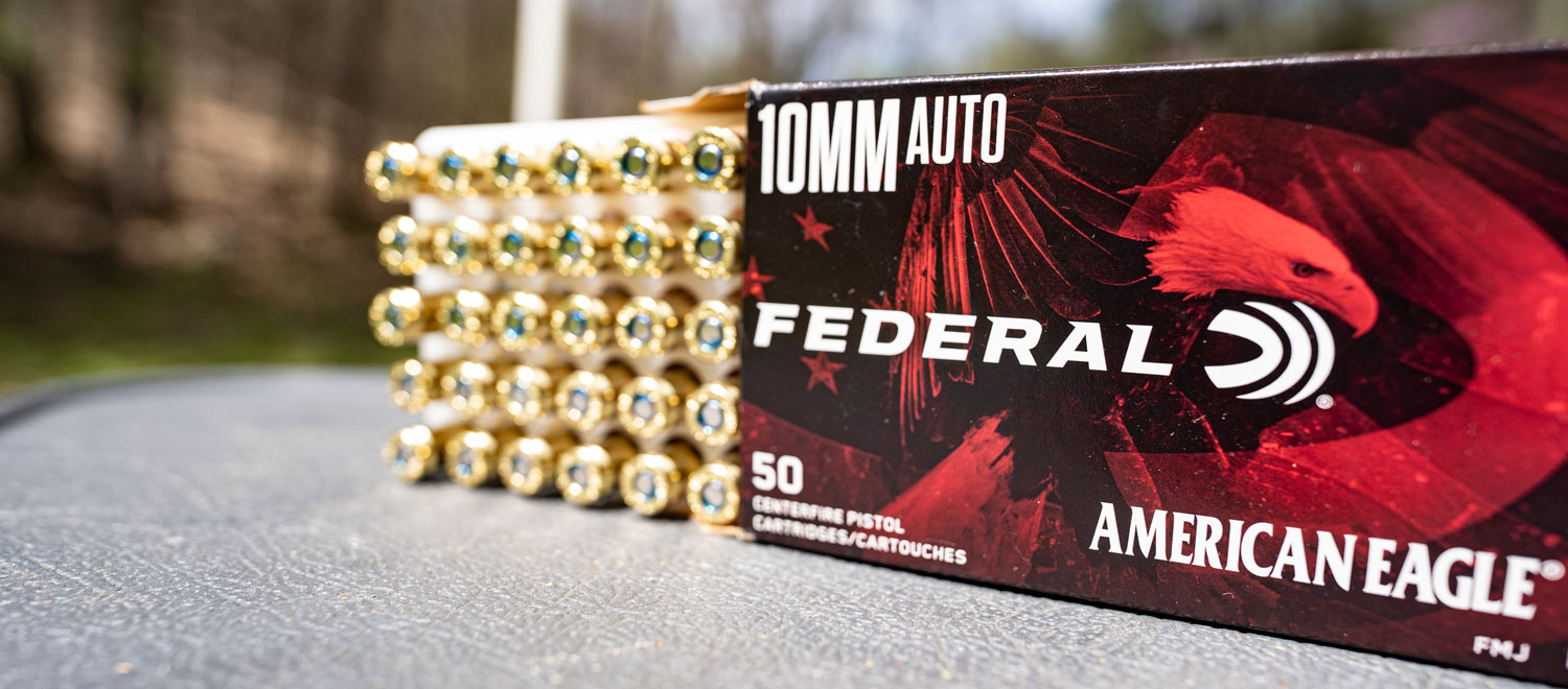 Box of Federal American Eagle 10mm ammo on a shooting bench
