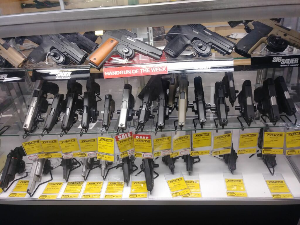 handguns displayed at a gun shop