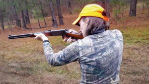 The author shooting a rifle at the range