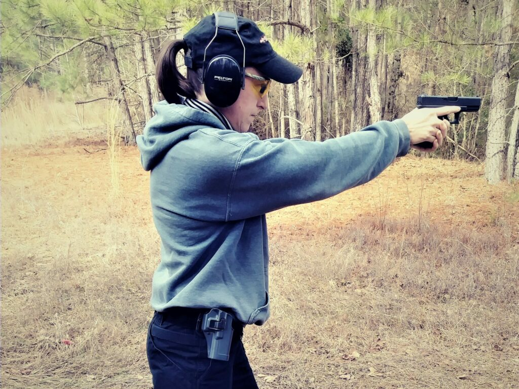 The author shooting her Glock 19 at the shooting range