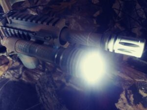 An AR-15 rifle equipped with a light for home defense