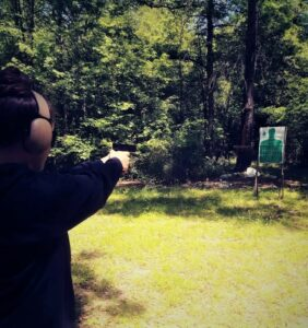 The author shooting the ball and dummy drill at an outdoor shooting range.