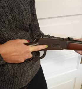 Working the action of a home defense lever action rifle