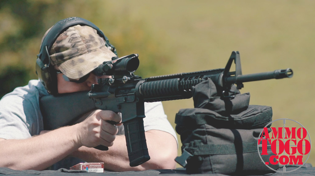 photo of a man shooting an AR-15 rifle