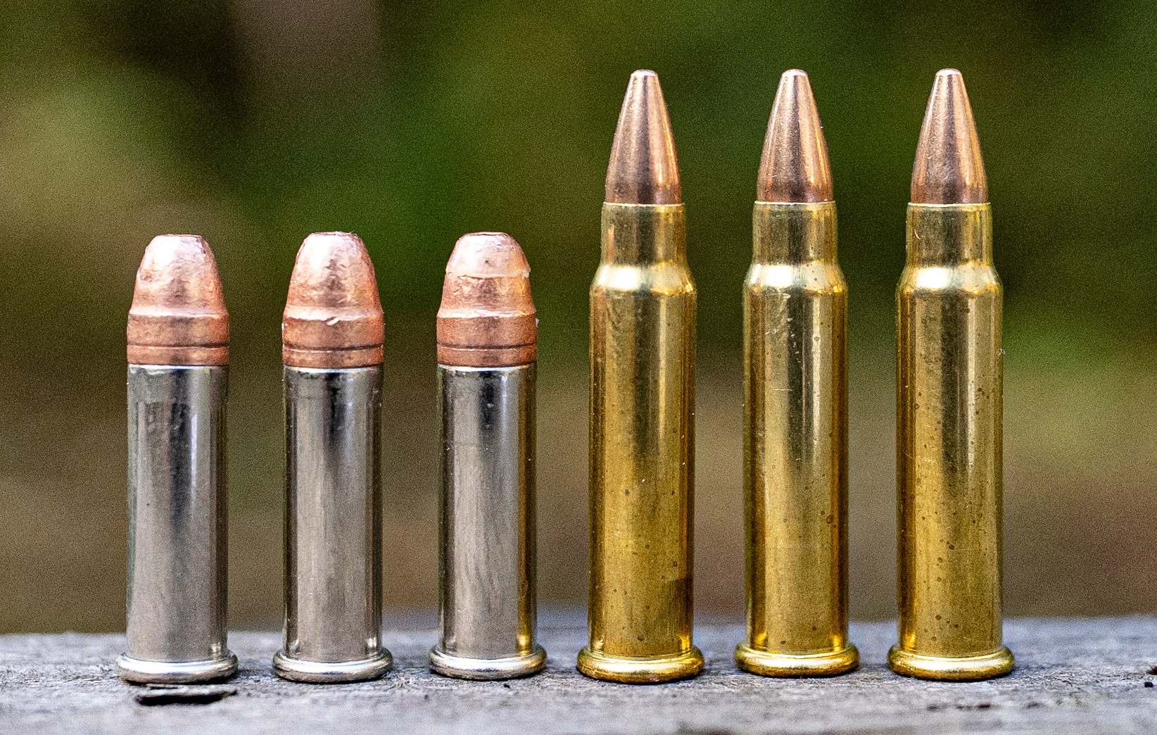 22lr ammo next to 17 hmr ammo at a shooting range