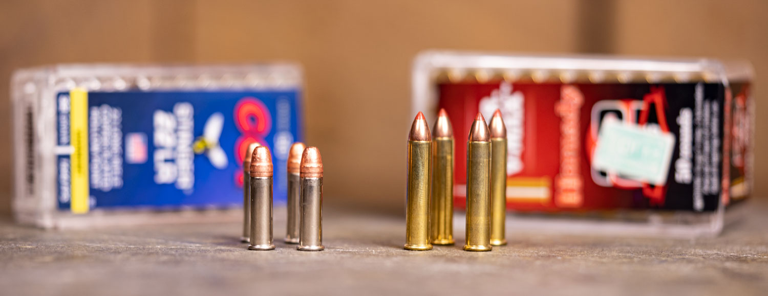22lr ammo and 22 wmr ammo side by side on a table