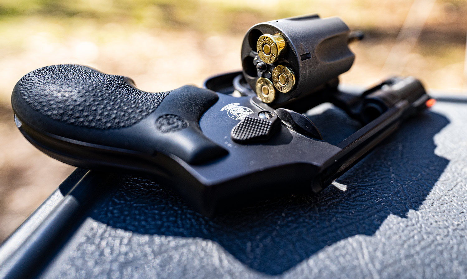 38 special ammo loaded in a revolver to test ballistic capabilities at a shooting range