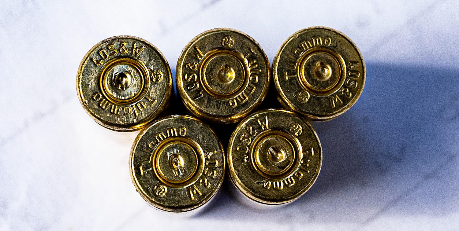 40 SW ammunition headstamps on a table
