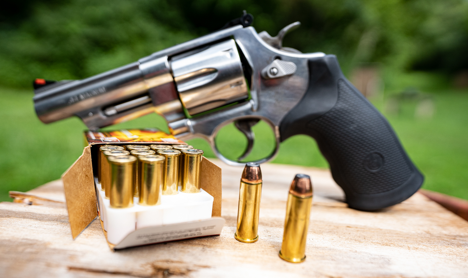 44 magnum revolver with ammunition at a shooting range