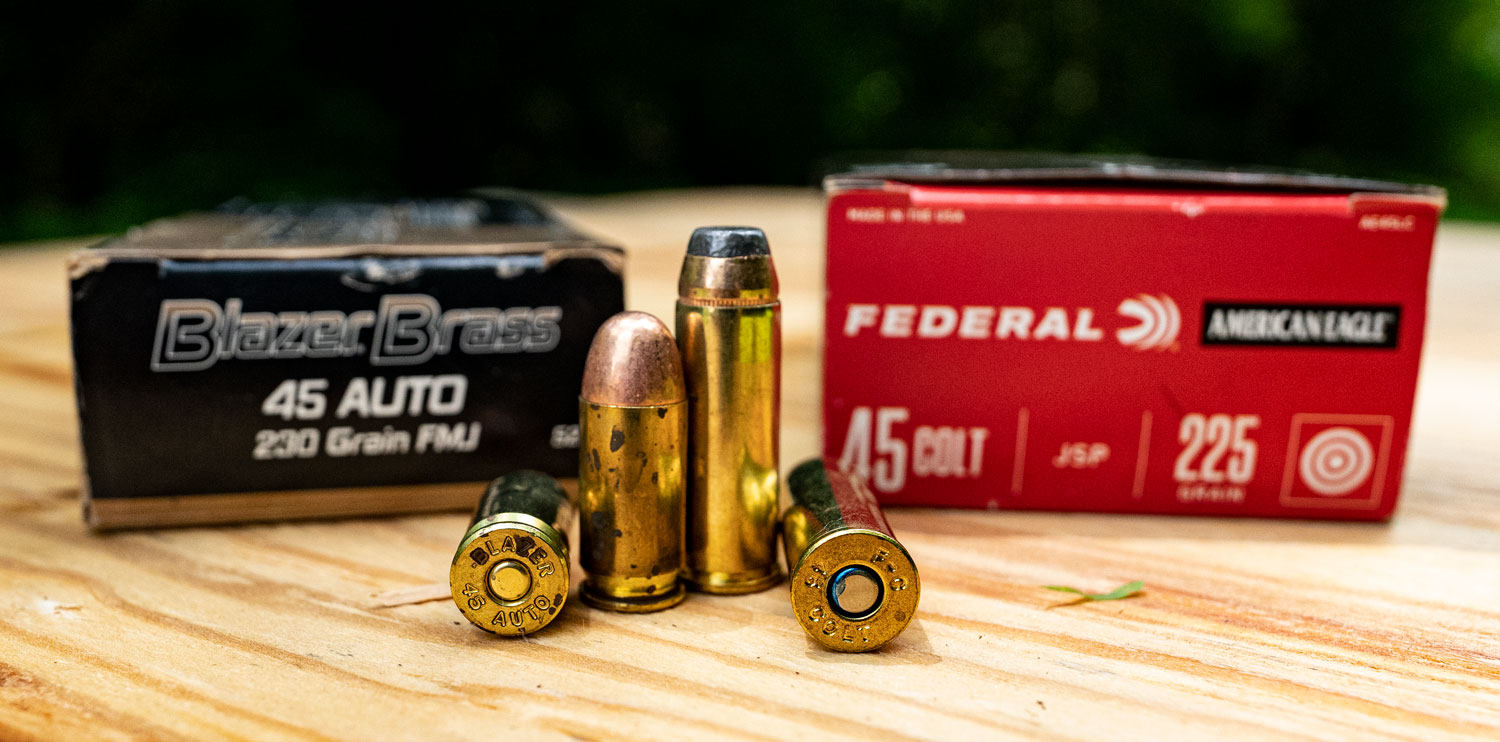 45 long colt vs 45 ACP ammo side by side