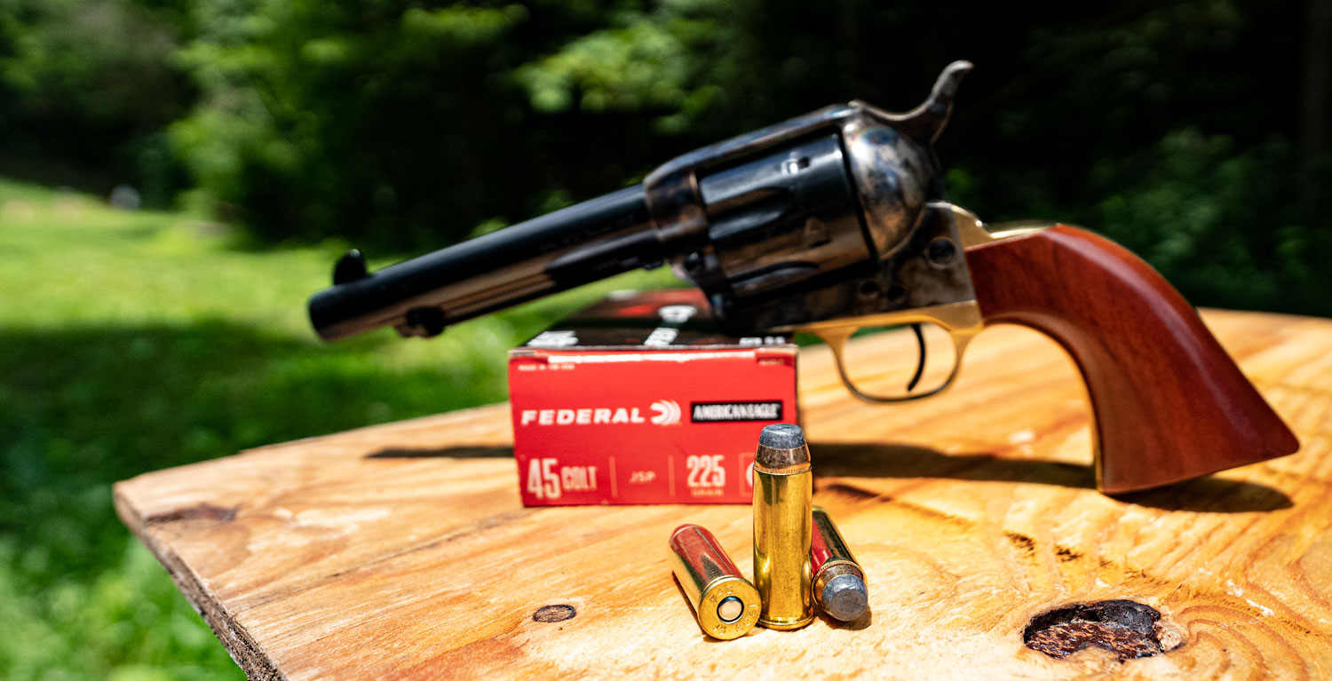 45 long colt revolver with ammunition at a shooting range