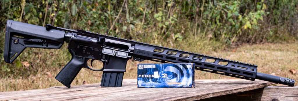 AR style rifle chambered in 450 bushmaster with ammo