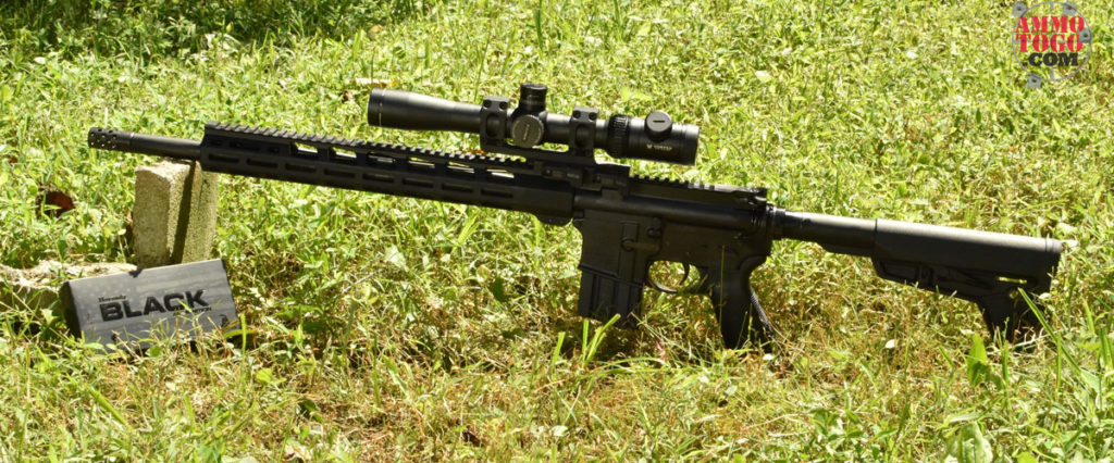 450 bushmaster rifle with ammo at the range