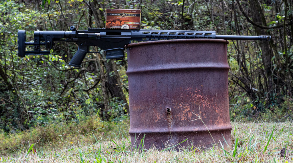 6.5 creedmoor rifle on a barrel with ammo