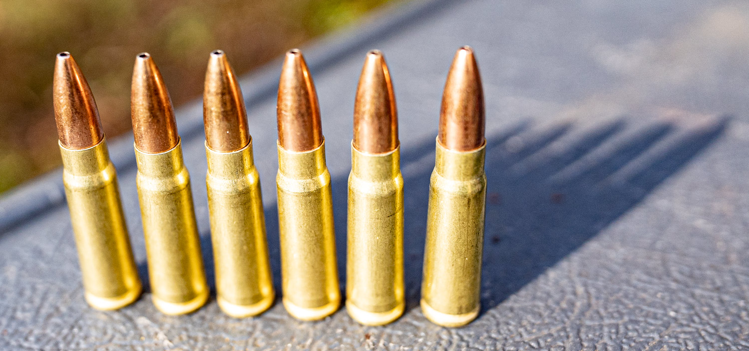 7.62x39 ammo cartridges lined up at a shooting range