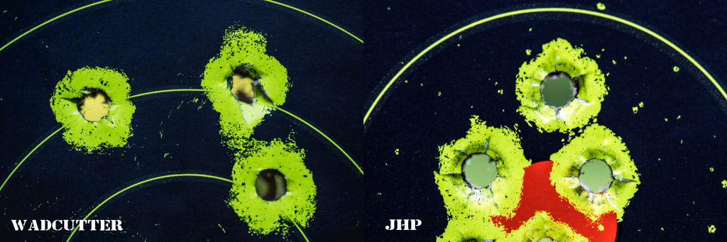 A side-by-side comparison of wadcutter bullet hole next to JHP bullet hole