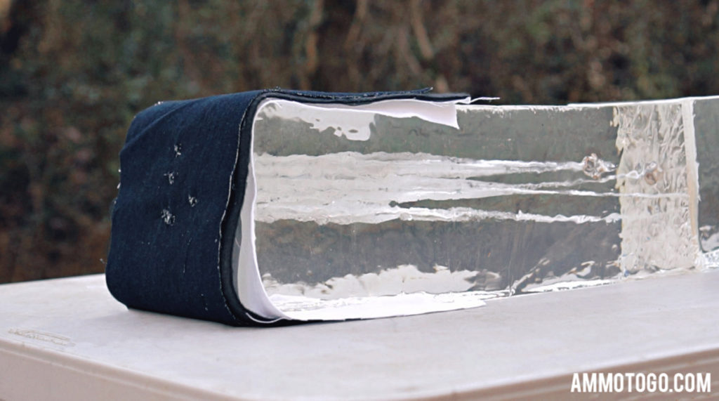 A photo showing the fabric clothing barrier for ballistic testing with gel blocks.