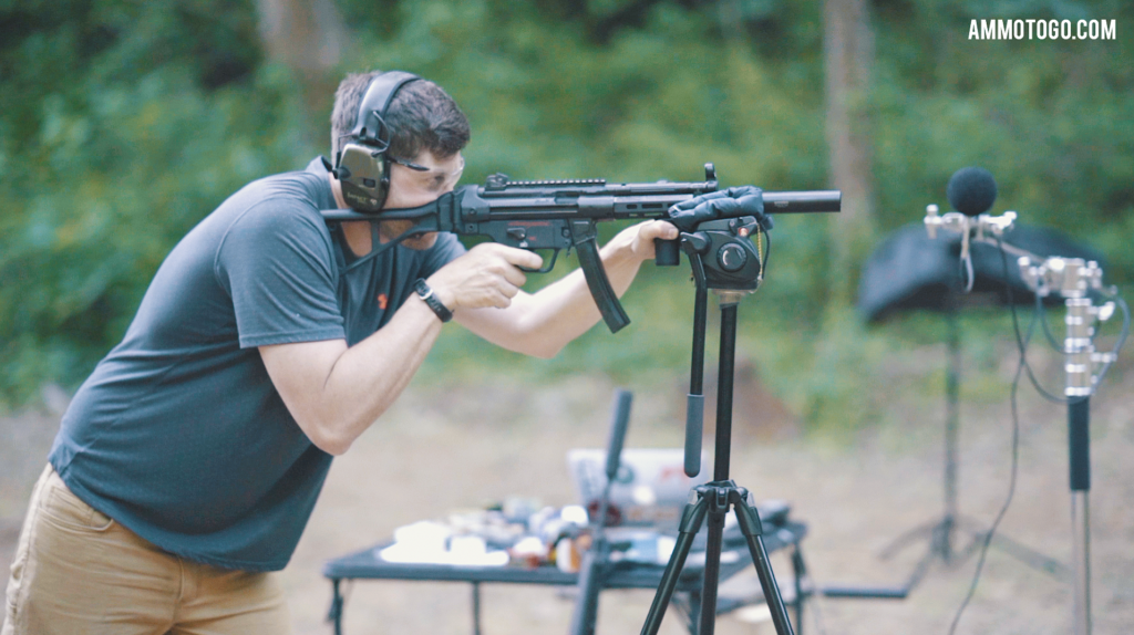 A man testing the audio levels of gun silencers