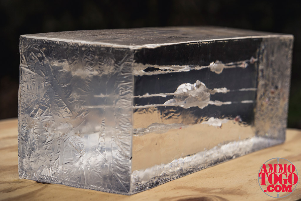 photo of a ballistic gel block on a sheet of plywood