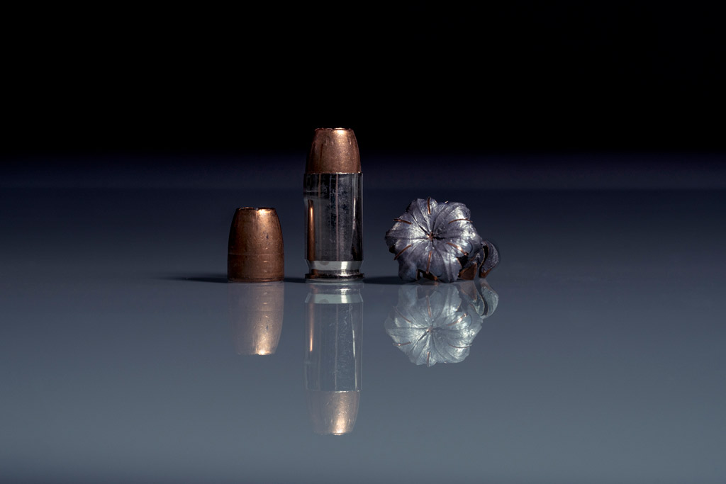 photo of .380 acp ammo with reflection