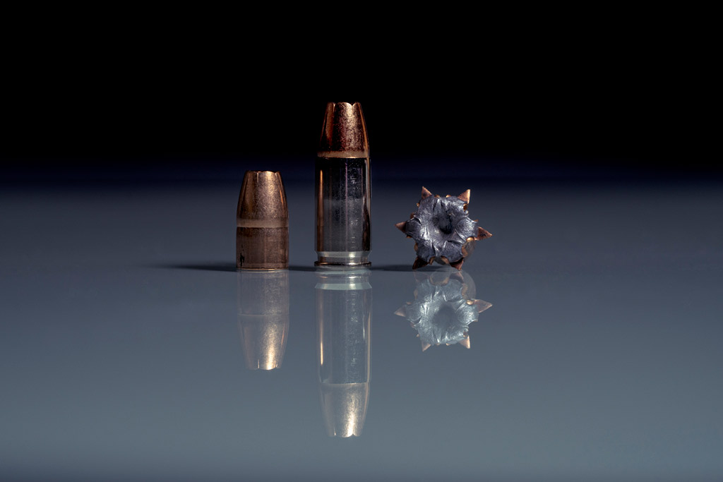 photo of 9mm ammo with reflection
