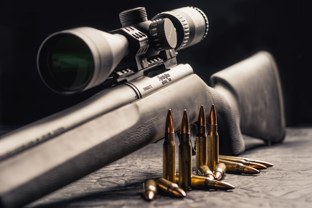 photo of a Remington 700 rifle with 308 ammo and scope