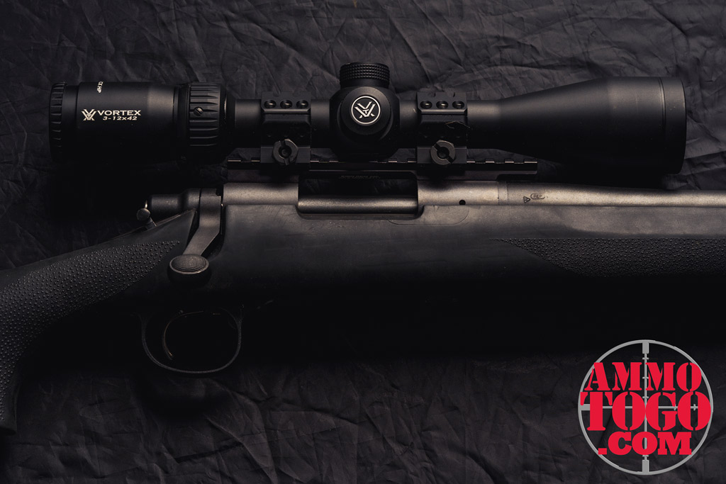 photo of remington rifle with a vortex scope