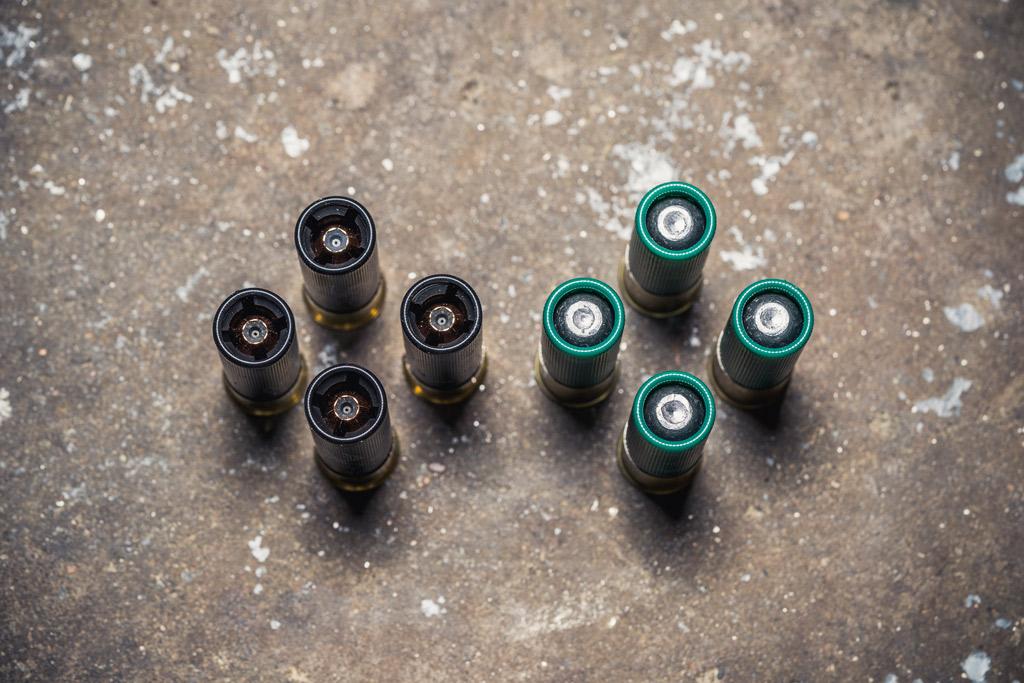 photo of sabot slugs next to lead slugs on a concrete floor