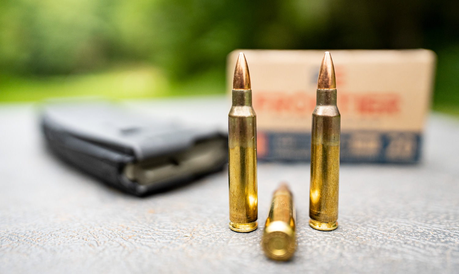Brass cased ammo on a shooting bench