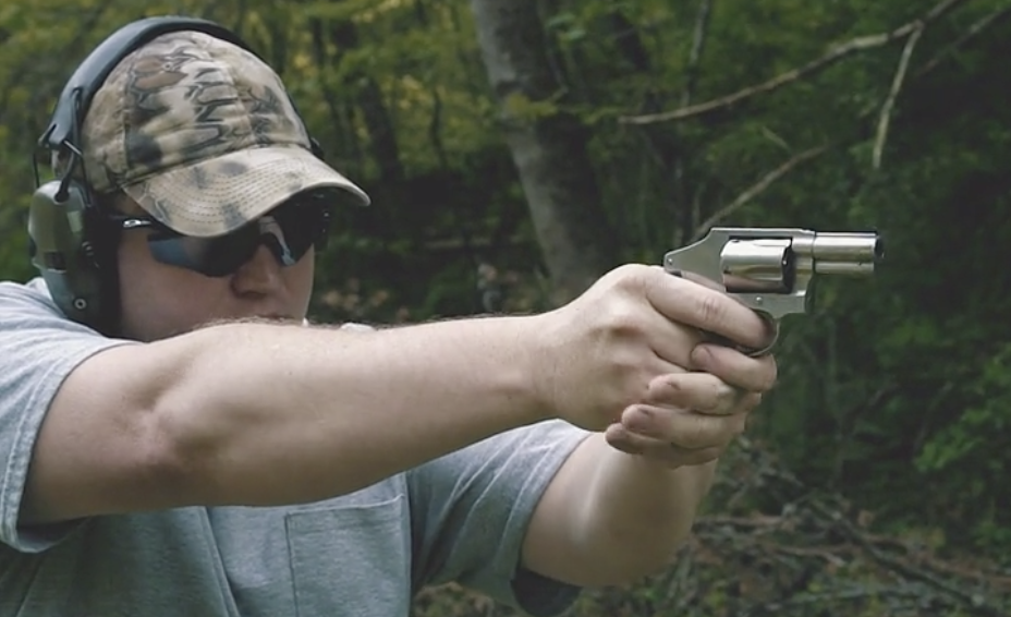 Firing a 357 magnum revolver at the shooting range