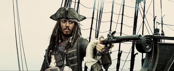 Captain Jack Sparrow points a muzzleloader pistol on a pirate ship