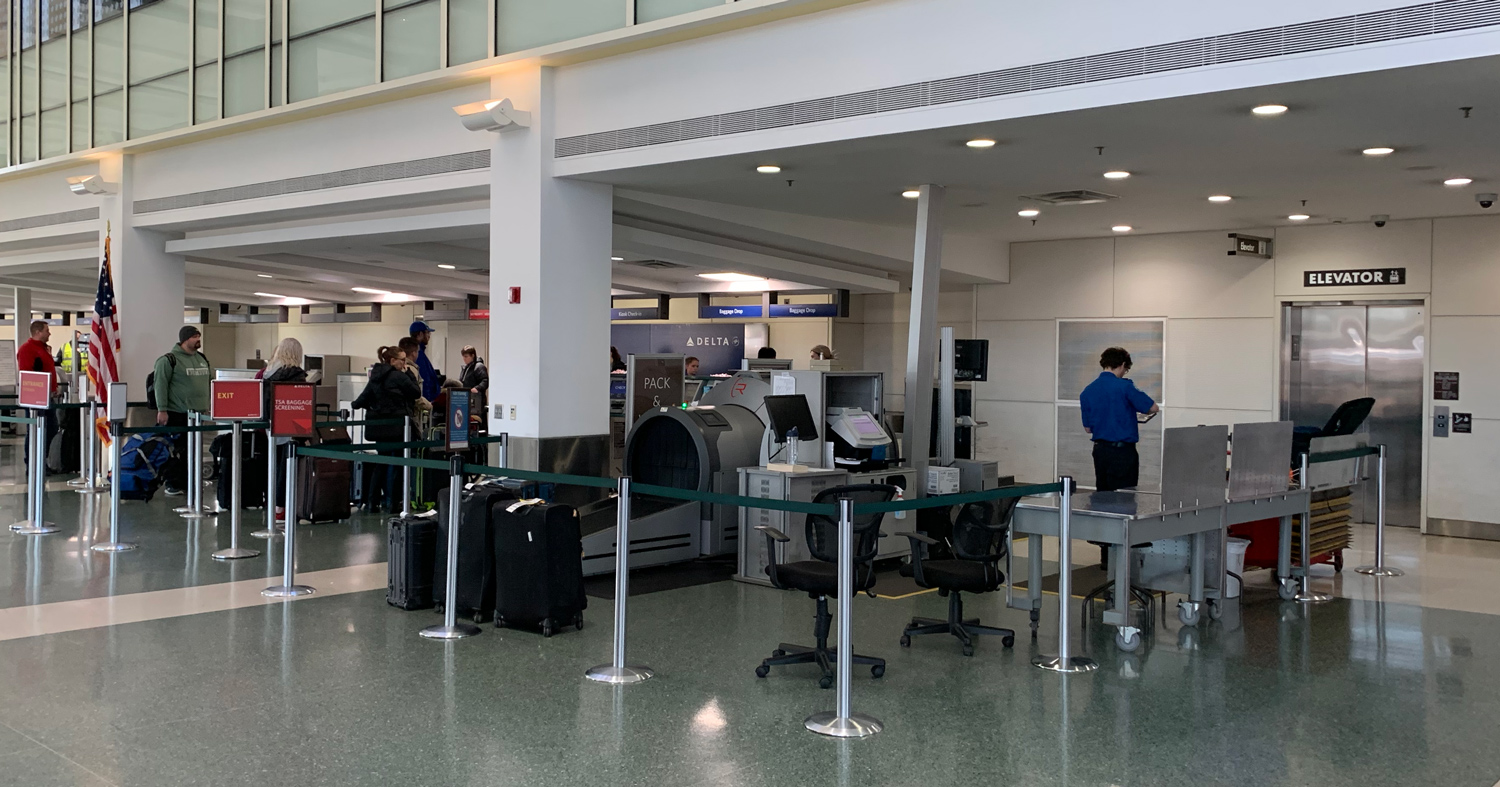 area at the airport for dropped bags, like firearm cases