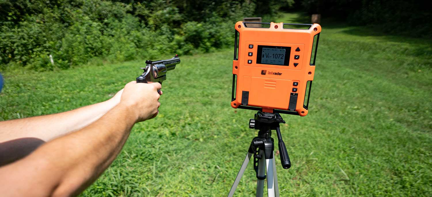 Measuring muzzle velocity of each caliber with a chronograph at a shooting range