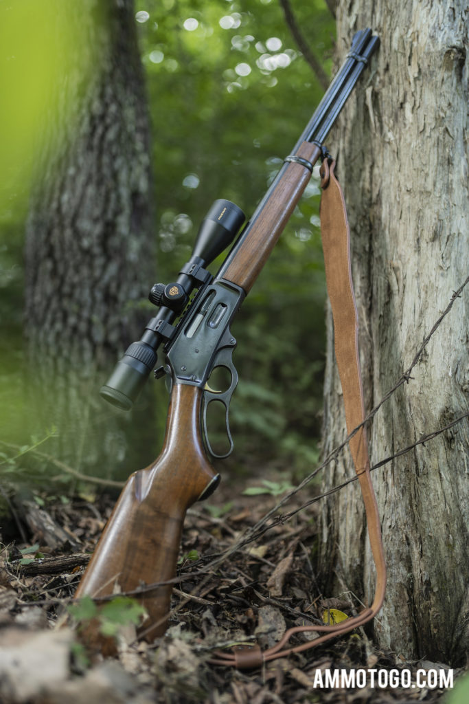 Marlin Model 336 rifle leaning against tree