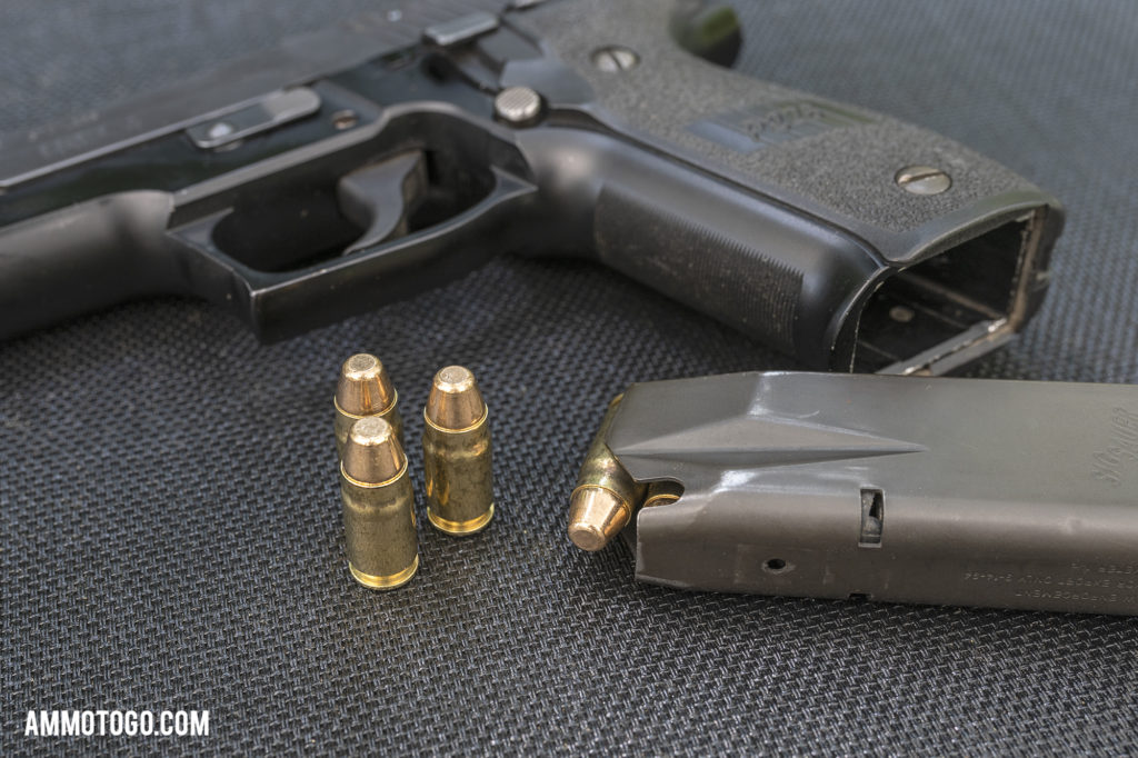Sig P226 handgun and magazine loaded with 357sig ammunition
