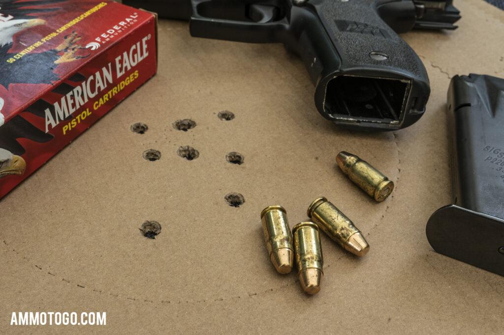 Sig P226 hangun with 357sig ammunition and shooting taget