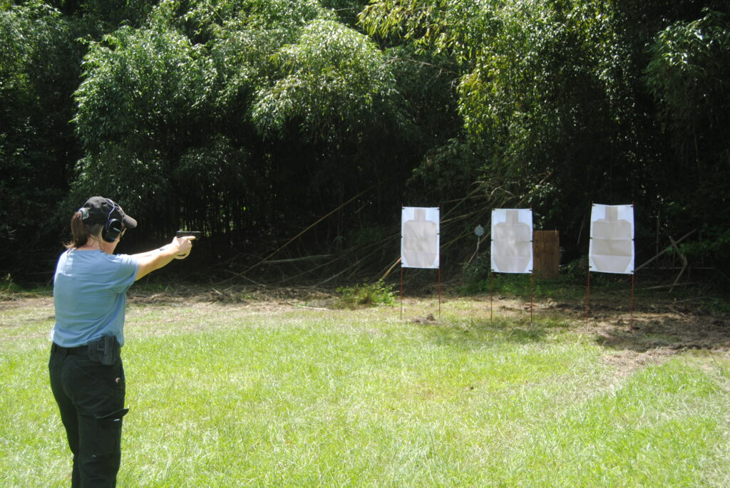 The author shooting the El Presidente drill outdoors at a range