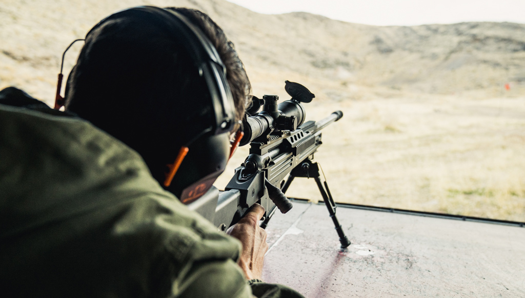 Firing a 338 Lapua rifle at a shooting range