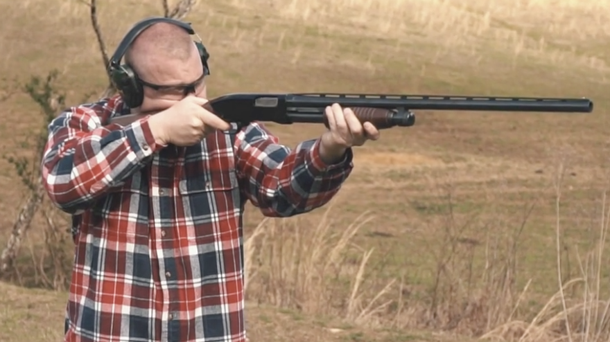 Firing a 12 gauge shotgun at the range