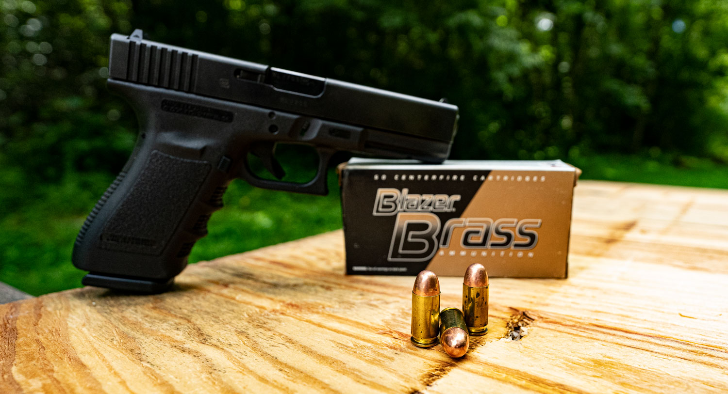 Glock 45 ACP pistol with Blazer Brass ammunition