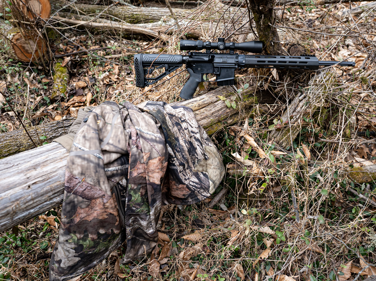 A 6.5 Grendel rifle in the woods