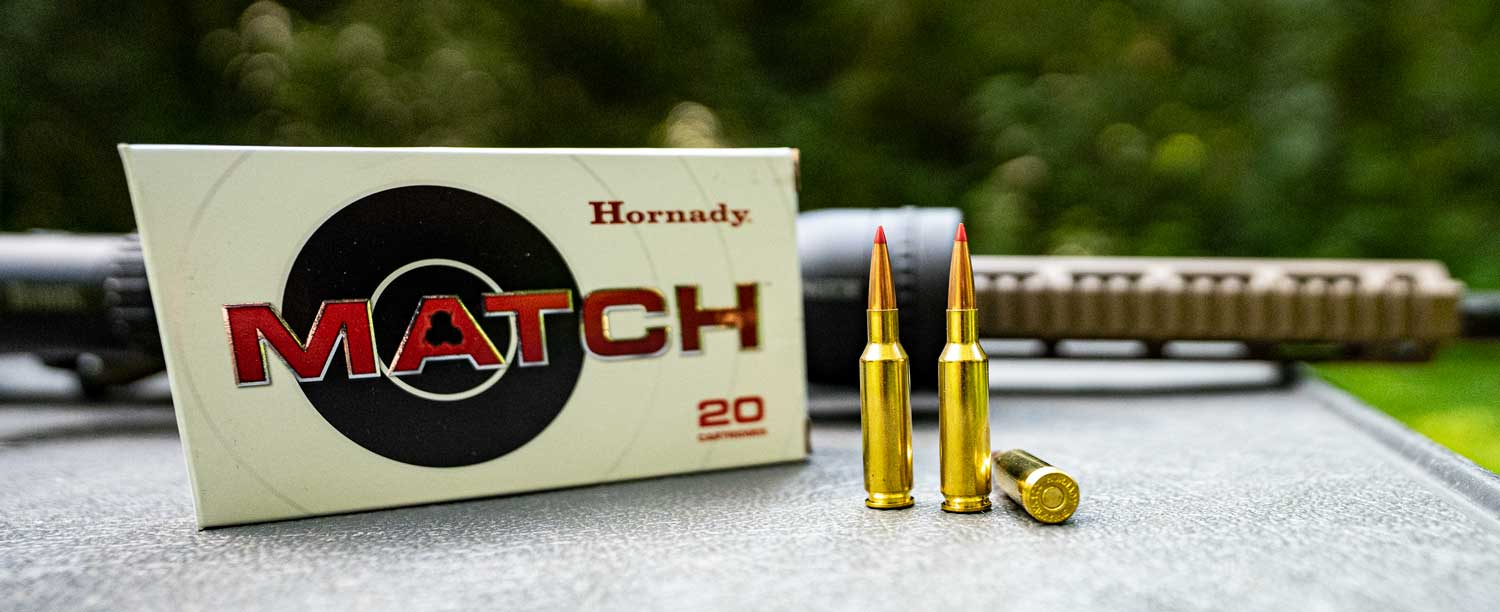 Hornady .224 Valkyrie ammo with a rifle at the range
