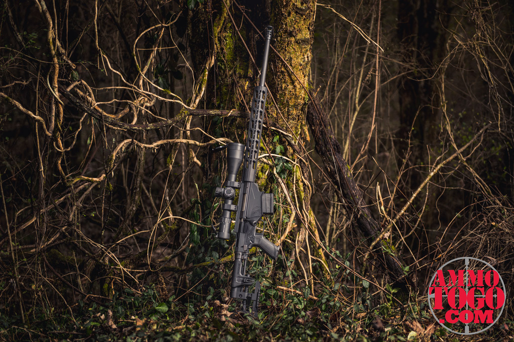 photo of a ruger precision rifle in 6.5 creedmoor outdoors against a tree