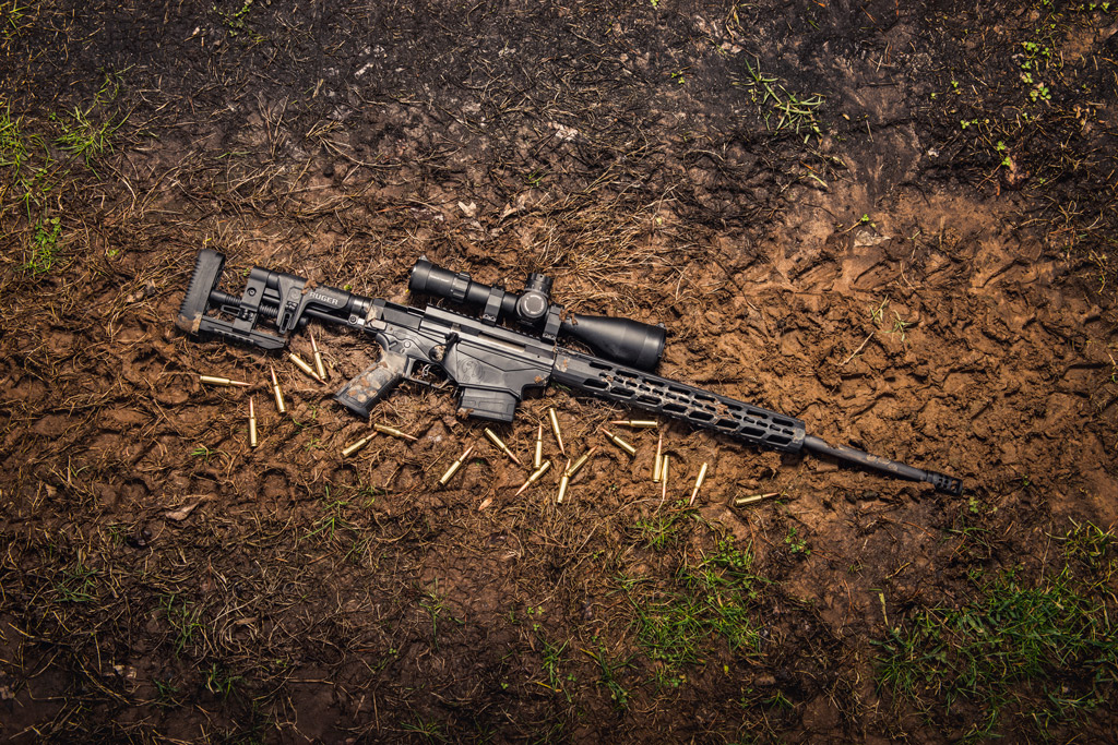 photo of the ruger precision rifle chambered in 6.5 creedmoor outside in the mud