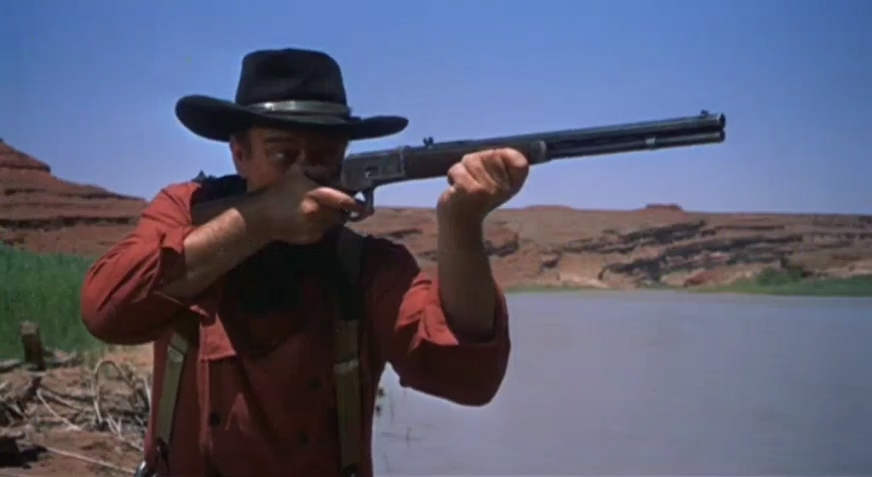John Wayne with a rifle in the film, The Searchers