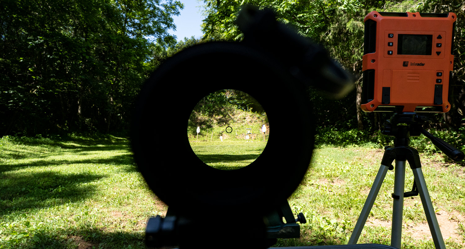 Looking through the scope of a 6.5 Grendel rifle downrange