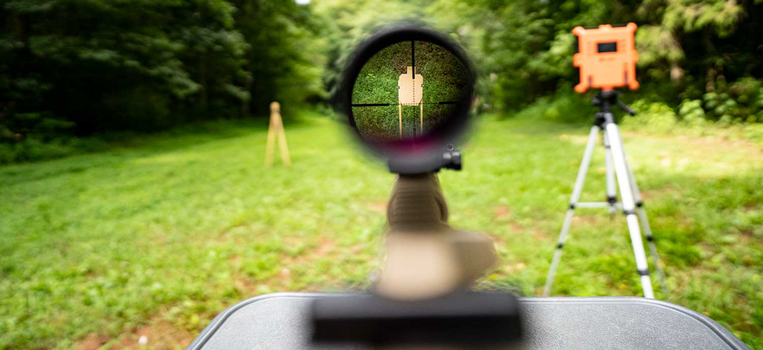 Looking through the scope of a rifle downrange