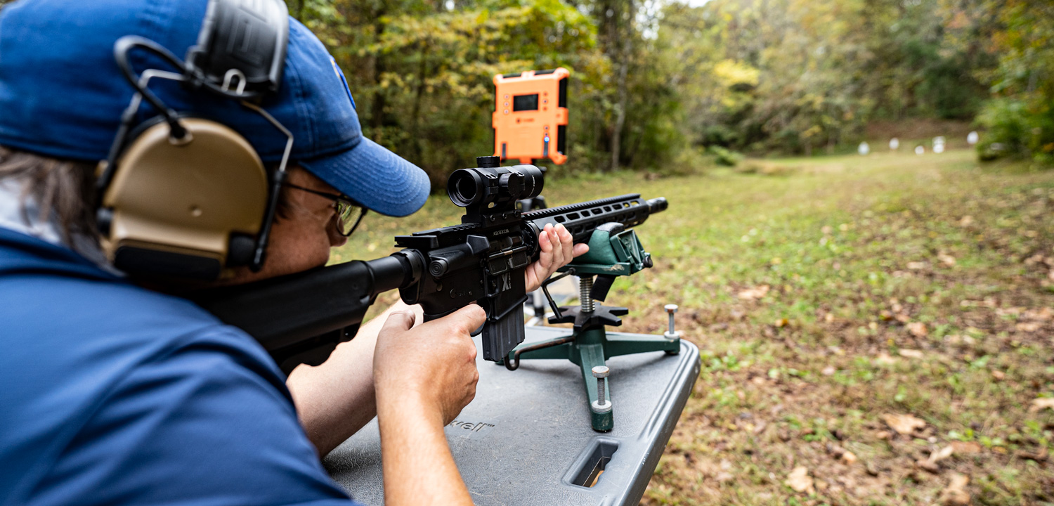 Shooting a 458 Socom rifle at a shooting range