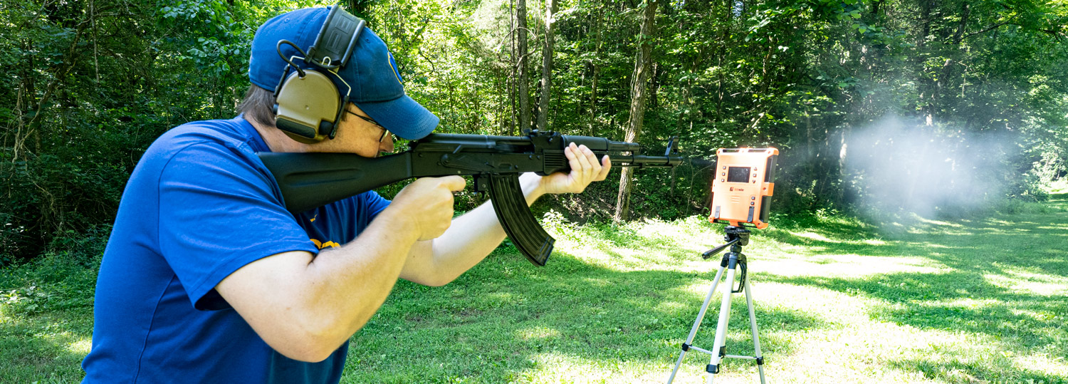 The author shooting 7.62x39 ammo with an AK-47 at a shooting range
