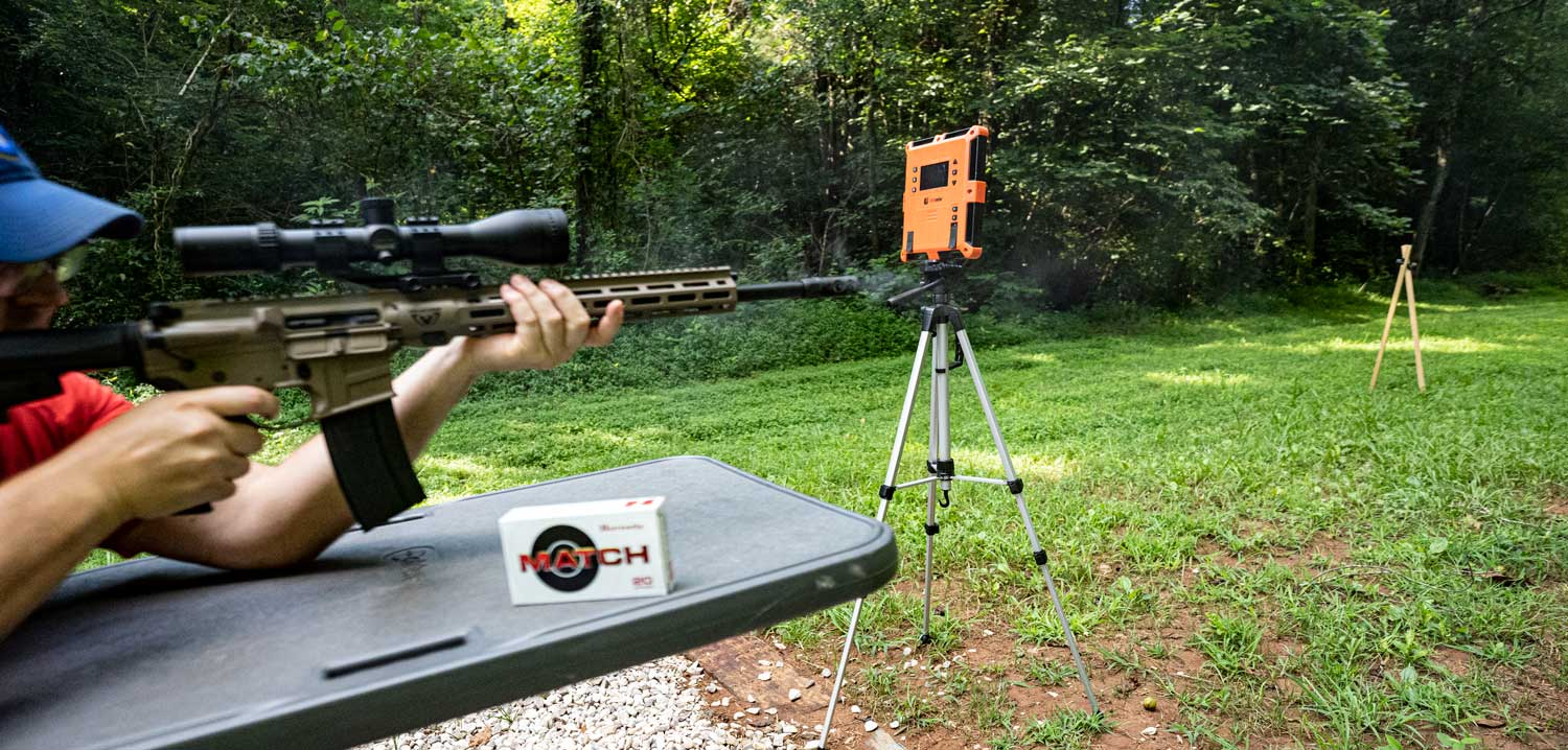 the author shooting a .224 valkyrie carbine at the range